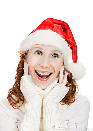 Happy Beautiful Christmas woman in santa hat