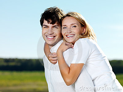 Happy beautiful couple in nature