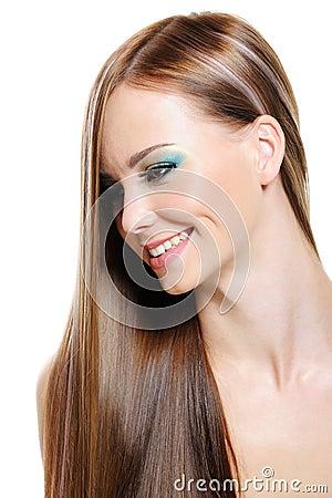 Happy beautiful girl with health gloss hair