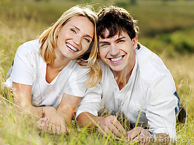 Happy beautiful laughing couple on nature