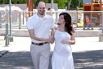 Happy beautiful pregnant woman and her husband