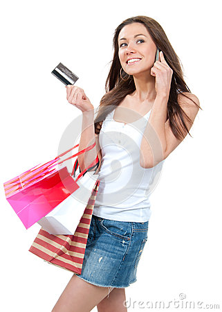 Happy Beautiful woman with shopping bags and credit gift card