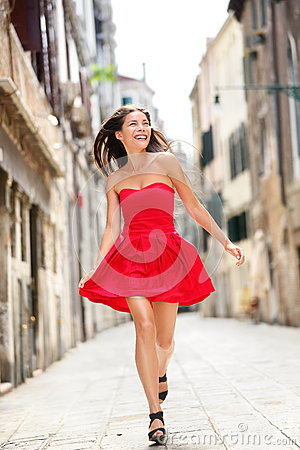 Happy beautiful woman in summer dress in Venice