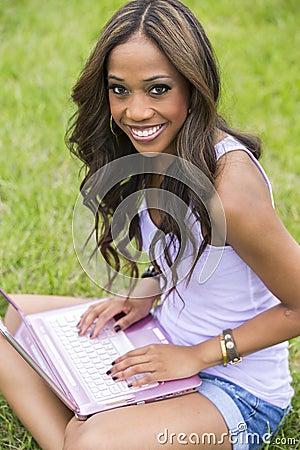 Happy beautiful woman using computer