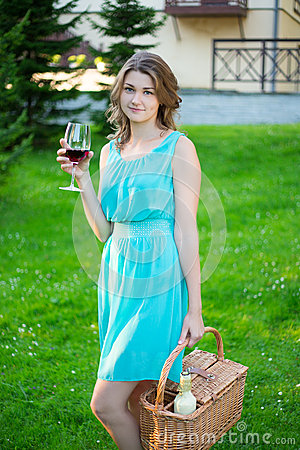 Free Happy Beautiful Woman With Picnic Basket Drinking Wine In Park Royalty Free Stock Photo - 62697325