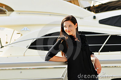 Happy beautiful woman in yacht club