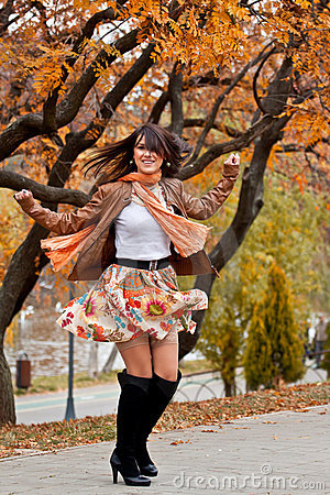 Free Happy Beautiful Young Woman Turning Around Royalty Free Stock Image - 22008206