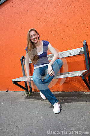 Free Happy Beautiful Young Woman With Crossed Legs Enjoying Sunny Break Royalty Free Stock Images - 75865479