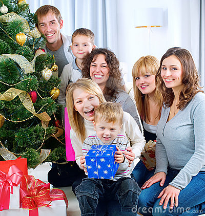 Happy Big family holding Christmas presents at hom