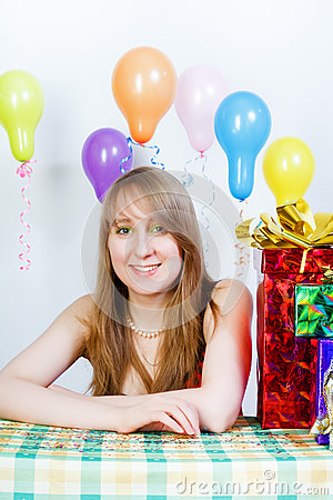 Happy birthday. Attractive young girl with gifts