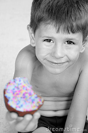 Happy birthday boy smiling with cupcake