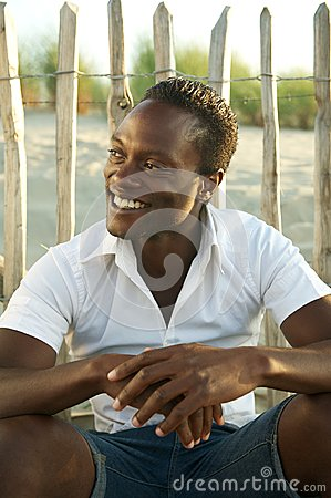 Happy black man smiling outdoors