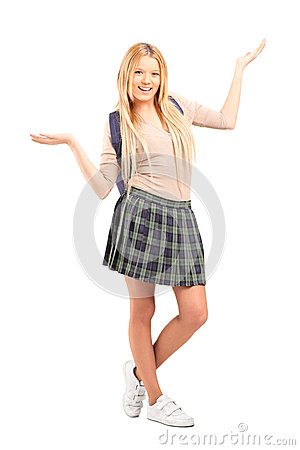 Happy blond female student with raised hands