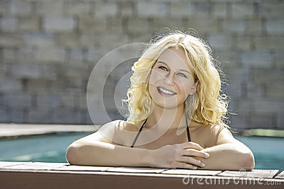 Happy blond girl in pool