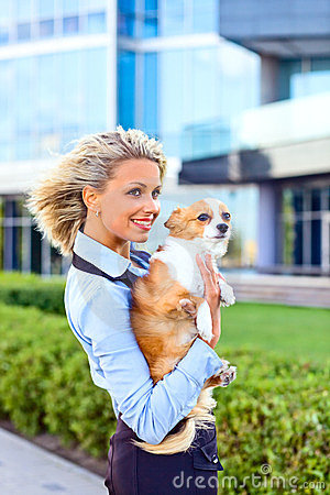 Happy blond woman with chihuahua.