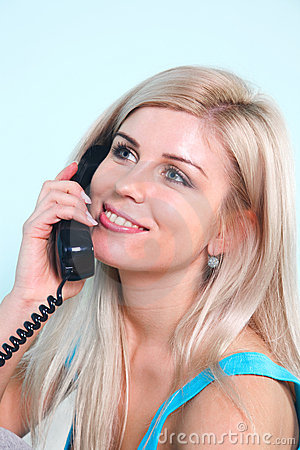 Happy blond woman on the telephone