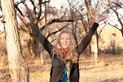 Happy Blond Woman Throwing Leaves