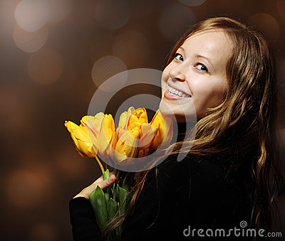Happy blond  woman with tulips