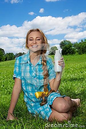 Happy blonde girl with milkshake