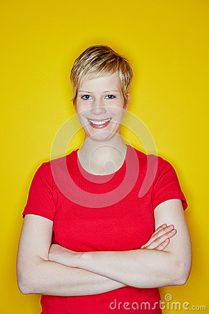 Happy blonde woman with arms crossed