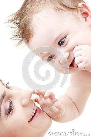 Happy blue-eyed baby boy touching mama