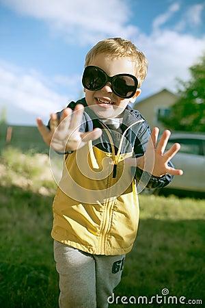 Happy boy in big sunglasses outdoor