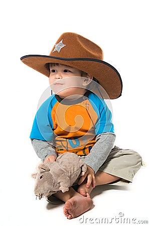 Happy boy in cowboy hat