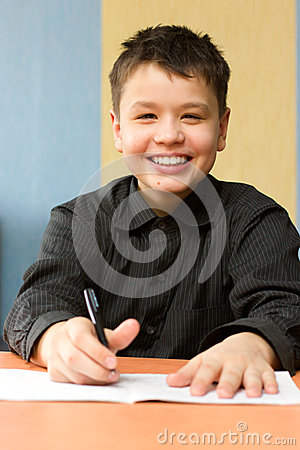 Happy boy doing lessons