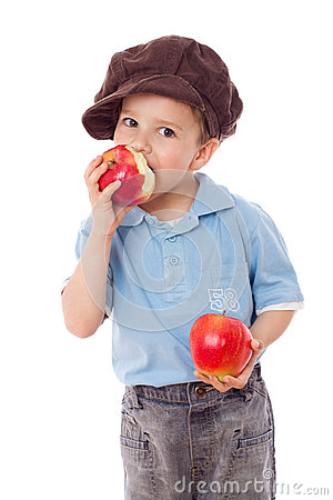 Happy boy eating red apples
