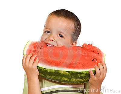 Happy boy eating watermelon