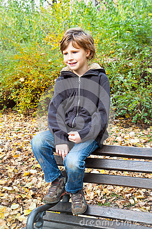 Happy boy enjoying in fall season