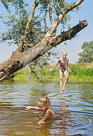 Happy boy and girl play in lake
