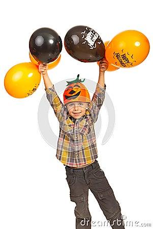Happy boy holding Halloween balloons