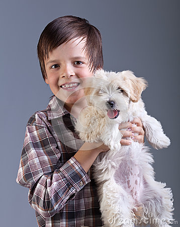 Happy boy holding his fluffy dog