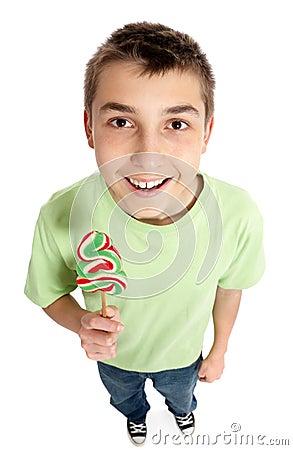Happy boy holding a lollipop candy