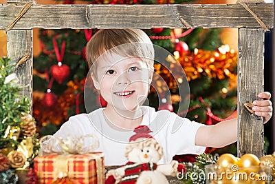 Happy boy looking into frame