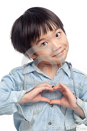 Happy boy making heart hand Stock Photo