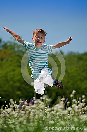 Happy boy on meadow