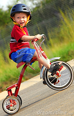 Free Happy Boy On Tricycle Royalty Free Stock Photography - 5080667