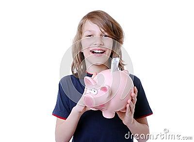 Happy boy with piggybank