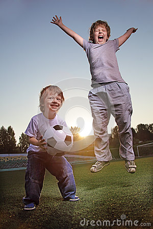 Happy boy play in soccer