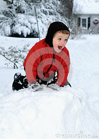 Happy Boy Playing in Snow