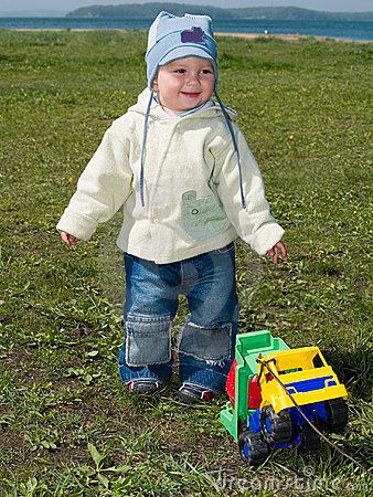 Happy boy playing with toy truck
