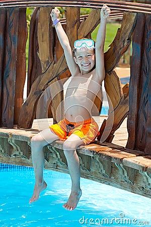 Happy boy by pool