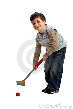 Happy boy preparing to hit a golf ball
