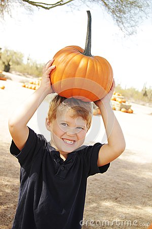 Happy boy at pumpkin patch