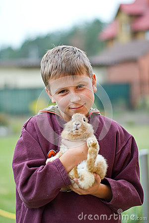 Happy boy with a rabbit
