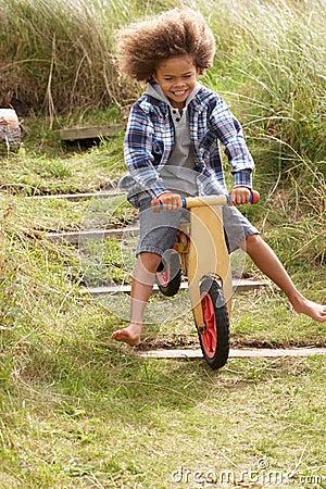 Happy boy riding a bike