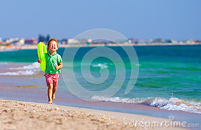 Happy boy running the beach, expressing delight