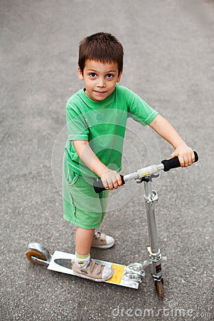 Happy boy with scooter